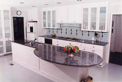 Private Residence, Chapel Hill. Blue Pearl granite, quarried in Norway, was used for the counters in this kitchen. The huge, curved overhang is supported by tubular steel that was designed, fabricated and installed by Prescott Stone Fabricators.