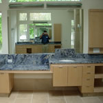 Private Residence Blue Bahia granite, very rare and quarried from boulders in Brazil, was specified for this Master Bath Retreat.  Note the varying levels of the vanities.  Prescott Stone collaborated closely with the cabinet and mirror shops to execute this design.