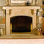 Private Residence, Chapel Hill. Fabricated in Germany to meet our design requirements, this fireplace is made of Sohlnhofen limestone. This particular job used sculpted cubes of stone for the supporting corbels and the mantle. The stone is a soft beige with light gray accents. It ranges